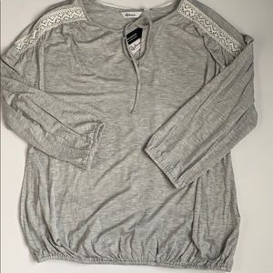 Grey top with lace inserts.